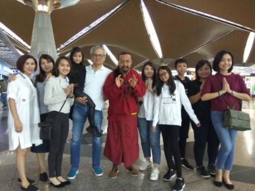 Rinpoche with students in Malaysia
